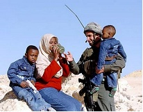Israeli soldier with Darfur refugees